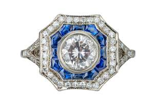 An Art Deco diamond and sapphire target cluster ring.