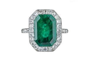 An Edwardian emerald and diamond ring.