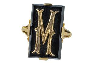 A yellow gold and onyx signet ring.