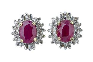 A pair of ruby and diamond ear studs.