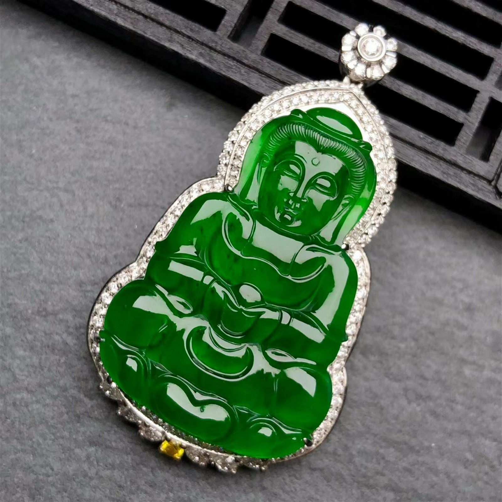 A Chinese Carved Jadeite Buddha with 18K Gold Inlaid