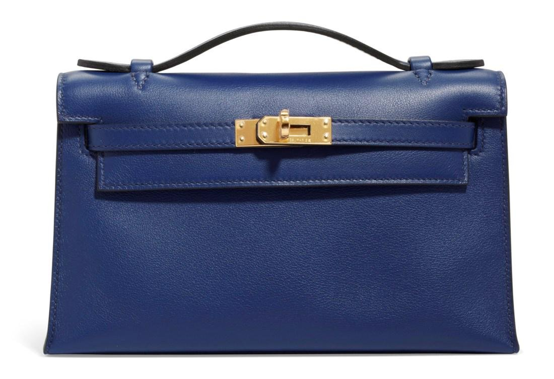 A BLEU SAPHIR SWIFT LEATHER KELLY POCHETTE WITH GOLD