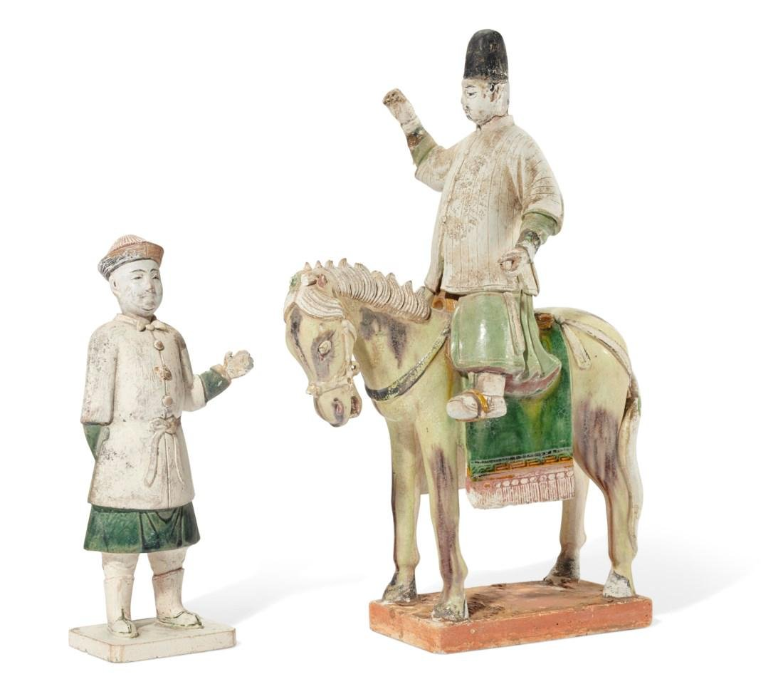 A PAINTED AND GLAZED POTTERY EQUESTRIAN FIGURE AND A