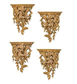 A SET OF FOUR GEORGE II STYLE LARGE GILTWOOD BRACKETS