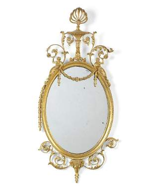 A GILTWOOD AND COMPOSITION MIRROR