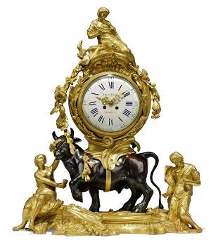 A FRENCH GILT AND PATINATED-BRONZE MANTLE CLOCK