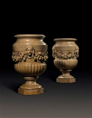 A PAIR OF LARGE ITALIAN YELLOW MARBLE URNS