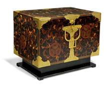 A JAPANESE GILT-METAL MOUNTED LACQUER COFFER ON STAND
