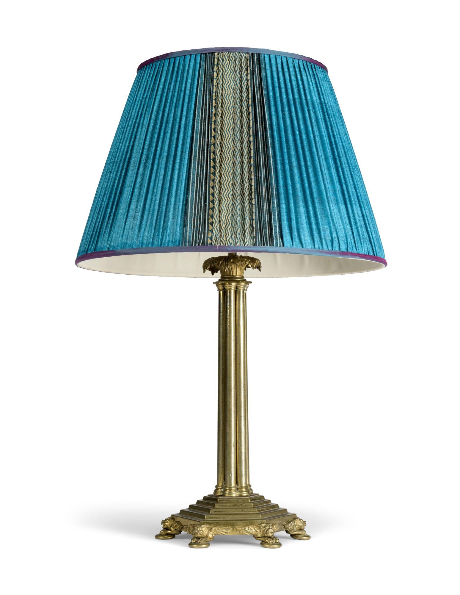 A LACQUERED-BRASS LAMP