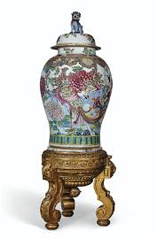 A MASSIVE FAMILLE ROSE JAR AND COVER