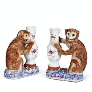 A PAIR OF MONKEY AND VASE GROUPS
