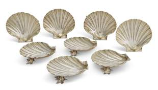 A GROUP OF EIGHT SILVER-GILT SHELL DISHES