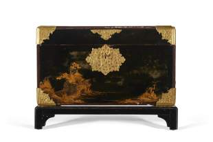 A JAPANESE BLACK AND GILT LACQUER CHEST ON STAND