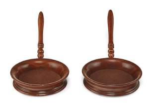 A PAIR OF VICTORIAN MAHOGANY HANDLED COASTERS