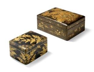 TWO JAPANESE GOLD AND BLACK LACQUER BOXES
