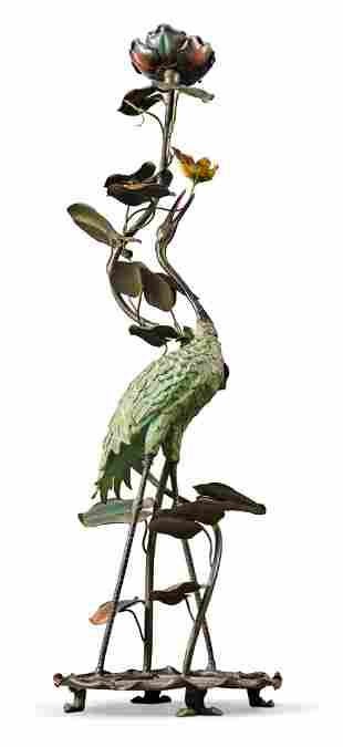 A COLD-PAINTED METAL TORCHERE MODELLED AS A CRANE