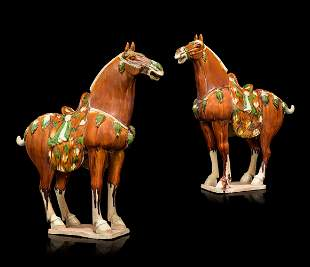 A PAIR OF CHINESE GLAZED POTTERY HORSES