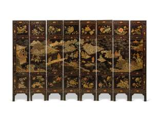 A CHINESE COROMANDEL LACQUER EIGHT-FOLD SCREEN