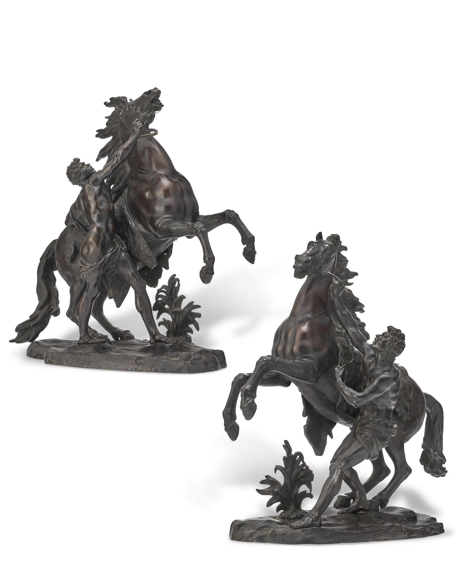 A PAIR OF FRENCH PATINATED BRONZE GROUPS OF THE MARLY