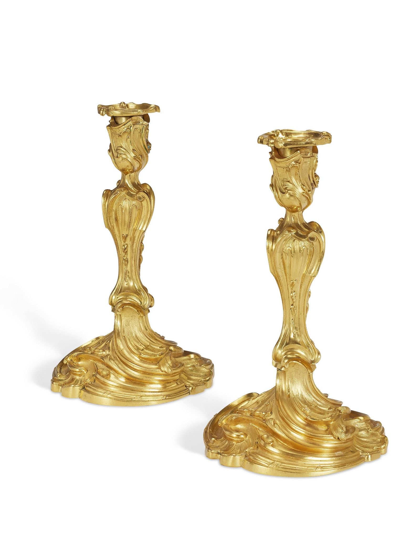 A PAIR OF FRENCH ORMOLU CANDLESTICKS