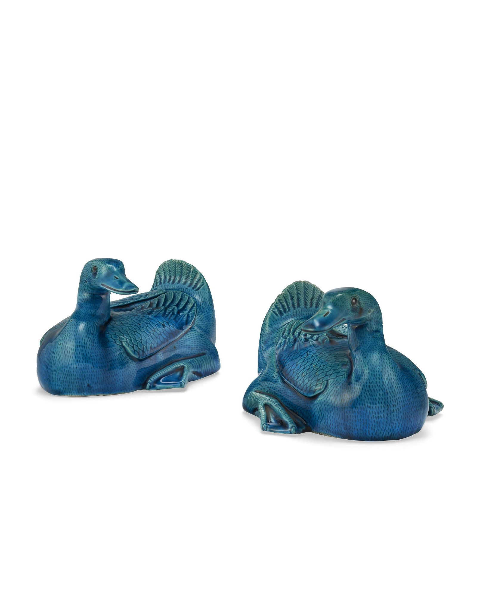 A PAIR OF CHINESE TURQUOISE-GLAZED DUCKS