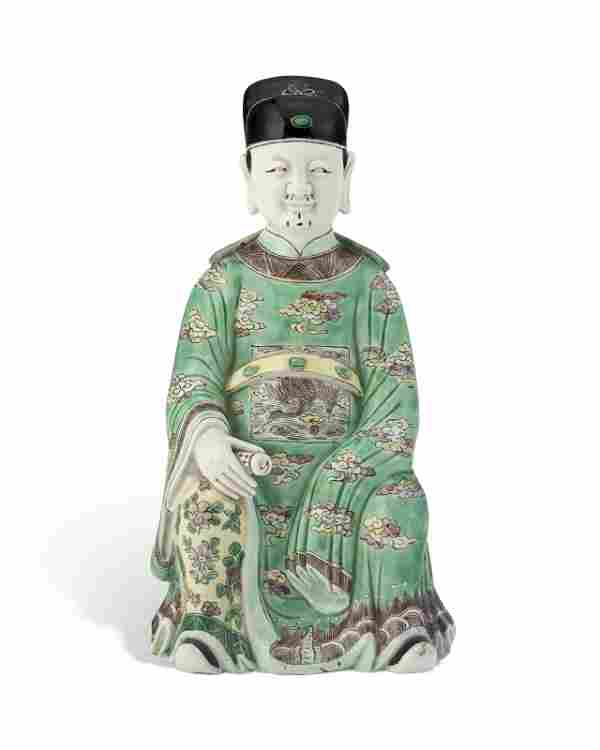A CHINESE FAMILLE VERTE FIGURE OF A DAOIST IMMORTAL