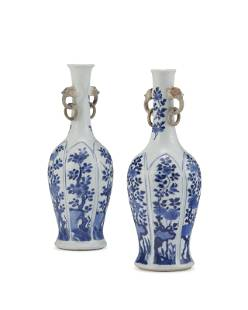 A PAIR OF CHINESE BLUE AND WHITE MOLDED VASES