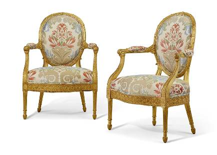 A PAIR OF GEORGE III GILTWOOD ARMCHAIRS