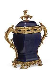 A LOUIS XV ORMOLU-MOUNTED CHINESE POWDER-BLUE PORCELAIN