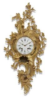 A LOUIS XV ORMOLU CARTEL CLOCK