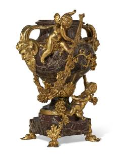 A FRENCH ORMOLU-MOUNTED ROUGE MARBLE URN ON PEDESTAL