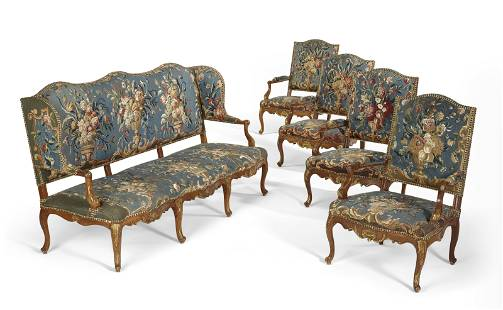 A SUITE OF EARLY LOUIS XV PARCEL-GILT WALNUT SEAT