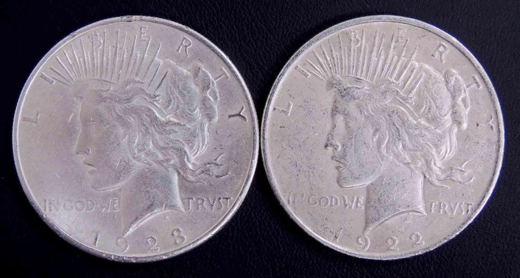 1922-d & 1923-s Peace silver dollars (2)