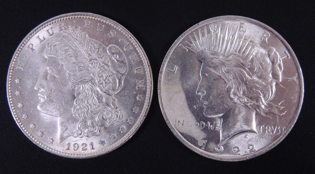 1921 Morgan and 1922 Peace silver dollars (2)