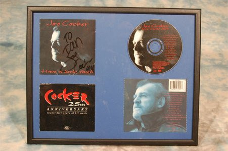 14: Joe Cocker. A framed CD display
