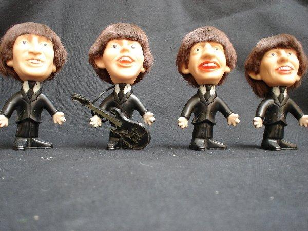 1555: Beatles mop top dolls