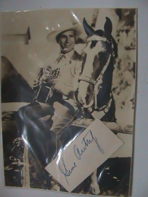 4: Gene Autry  - A b/w postcard of the guitar playing