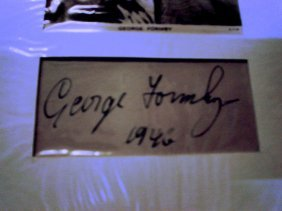 7: George Formby  - A clipped album page signed George