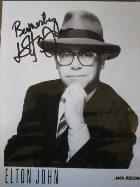 169: Elton John Signed publicity photograph