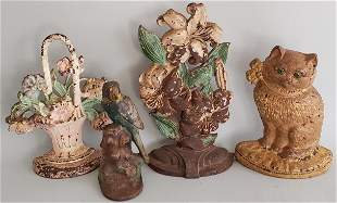 Four Antique Hubley Cast Iron Figural Doorstops