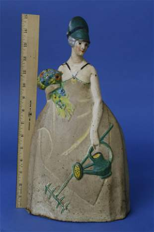 Cast Iron Painted Doorstop of a Lady with Flower