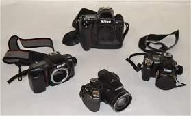 Selection of Nikon cameras including Nikon F5
