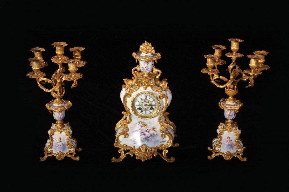 20: 3-Pce Gilt Bronze Scenic Sèvres Clock/Candelabras