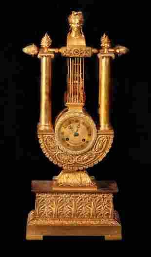 Empire Gilt Bronze Clock w/Reverse Pendulum Susp.