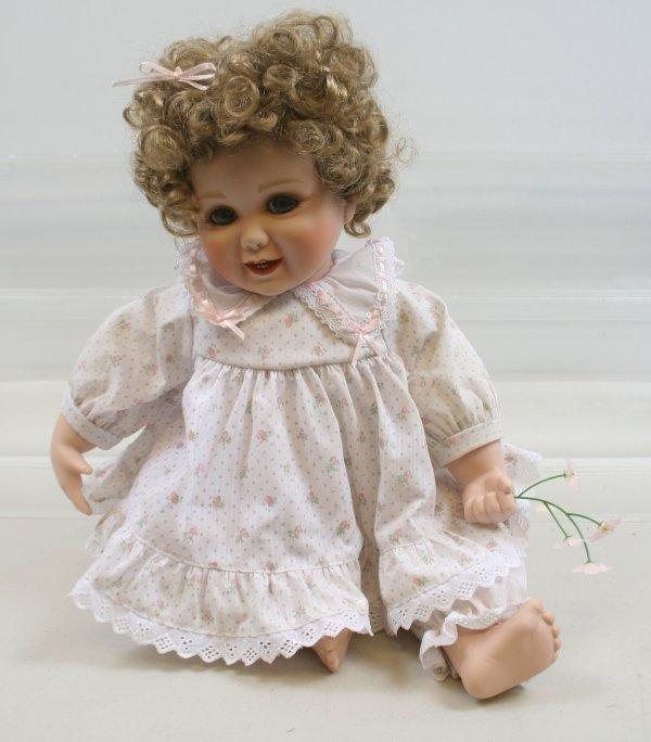 "625: 625: Camelot 13 1/2"" Porcelain Doll Sitting Down"