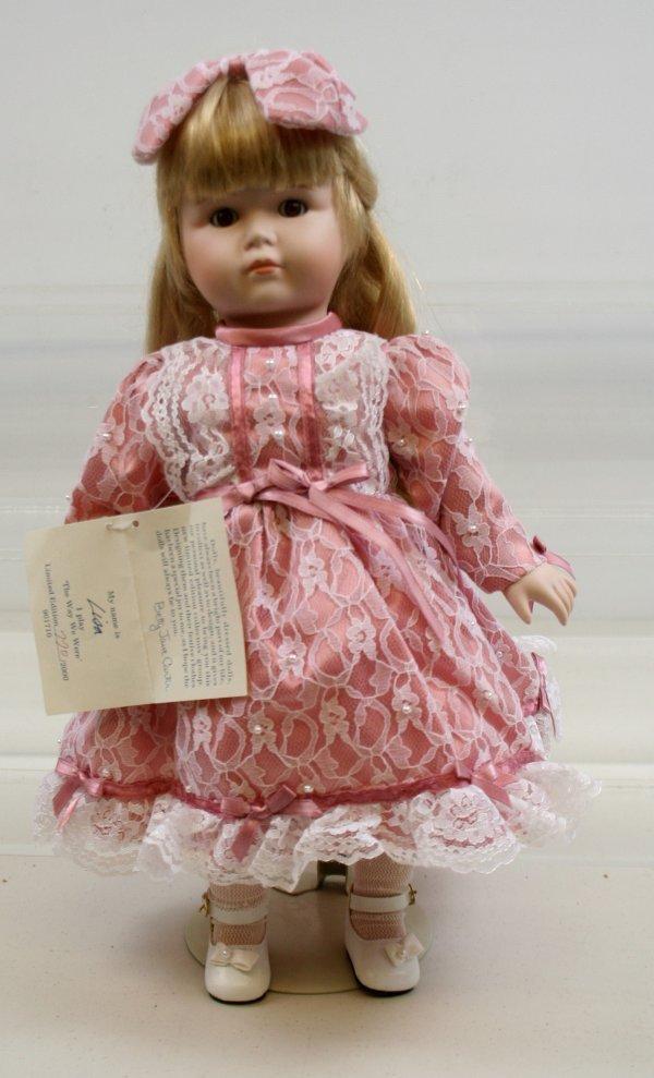 629: 629: Betty Jane Carter Porcelain Musical Doll Lisa