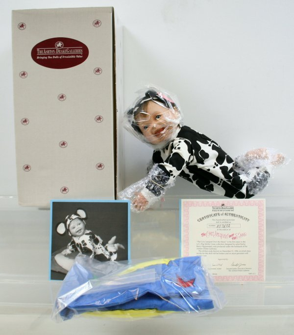642: 642: Cow Jumped over the Moon Porcelain Doll NIB
