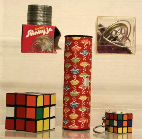 1523: Lot of misc. toys Slinky Jr. Rubix Cube and more