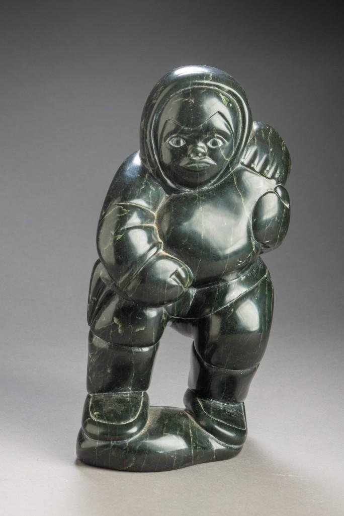 Signed Inuit Carving of a Seal Hunter.