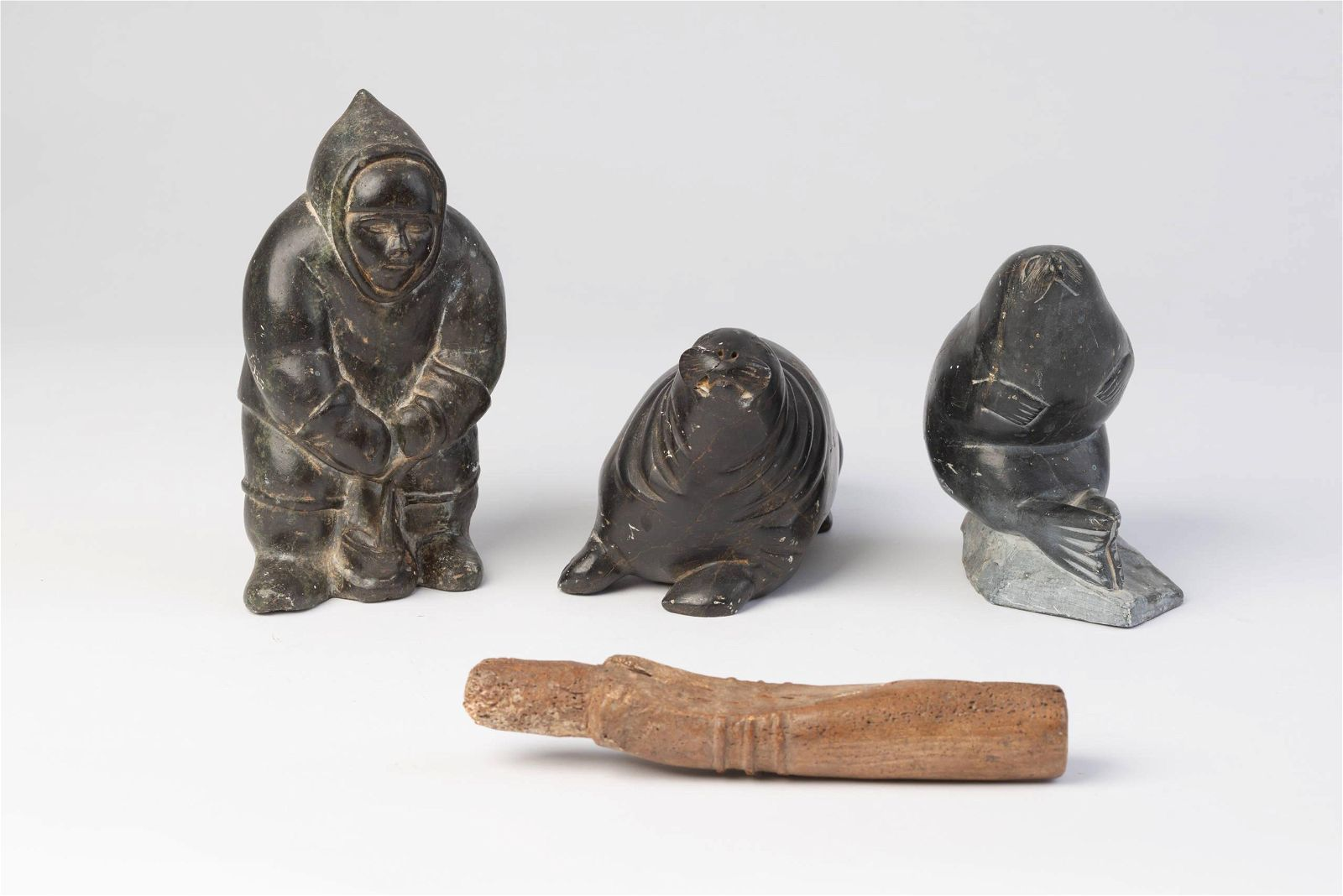 Four Inuit Carved Stone Figures.